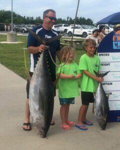 This 118.2lb Allison Yellowfin tuna graced the dock today during (This 118.2lb Allison Yellowfin tuna graced the dock today during the Kid's Carc…)