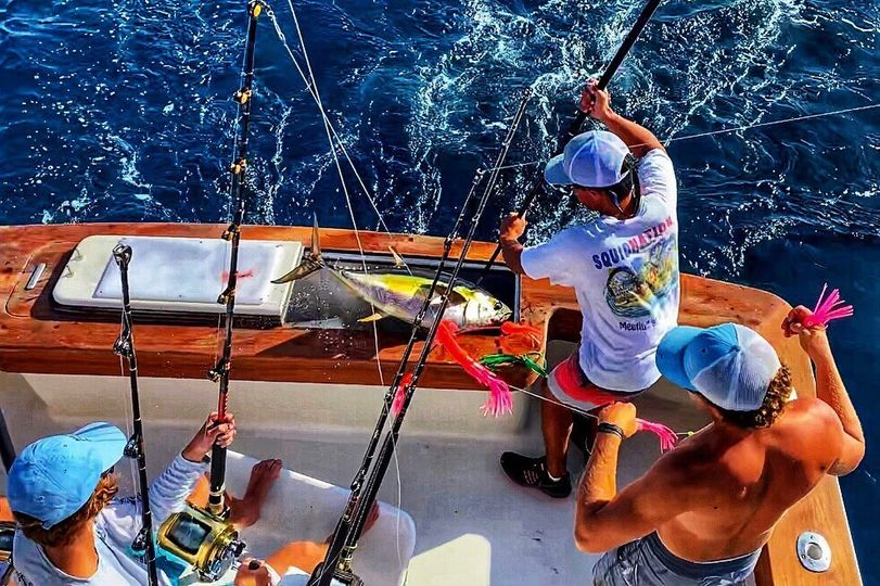 Pretty work getting Yellowfin in the box for young angler,
